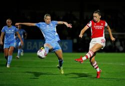 Soccer-Arsenal hammer injury-hit Man City to go top of Women's Super League