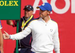 Golf-Emotional McIlroy earns Ryder Cup point, too little too late