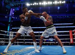 Boxing-Fury v Joshua bout unlikely to happen, says promoter Warren