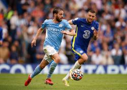 Soccer-Guardiola hails Silva's performance in unfamiliar role against Chelsea