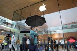 Some Apple, Tesla suppliers suspend production in China amid power pinch