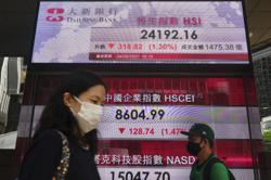 Asian shares mixed as virus fears cloud economic outlook