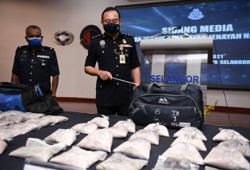 Police bust drug syndicate with arrest of nine, seizure of heroin worth RM910,000
