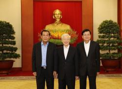 Leaders of Laos, Vietnam, Cambodia meet in Hanoi and agree to further strengthen friendly relations
