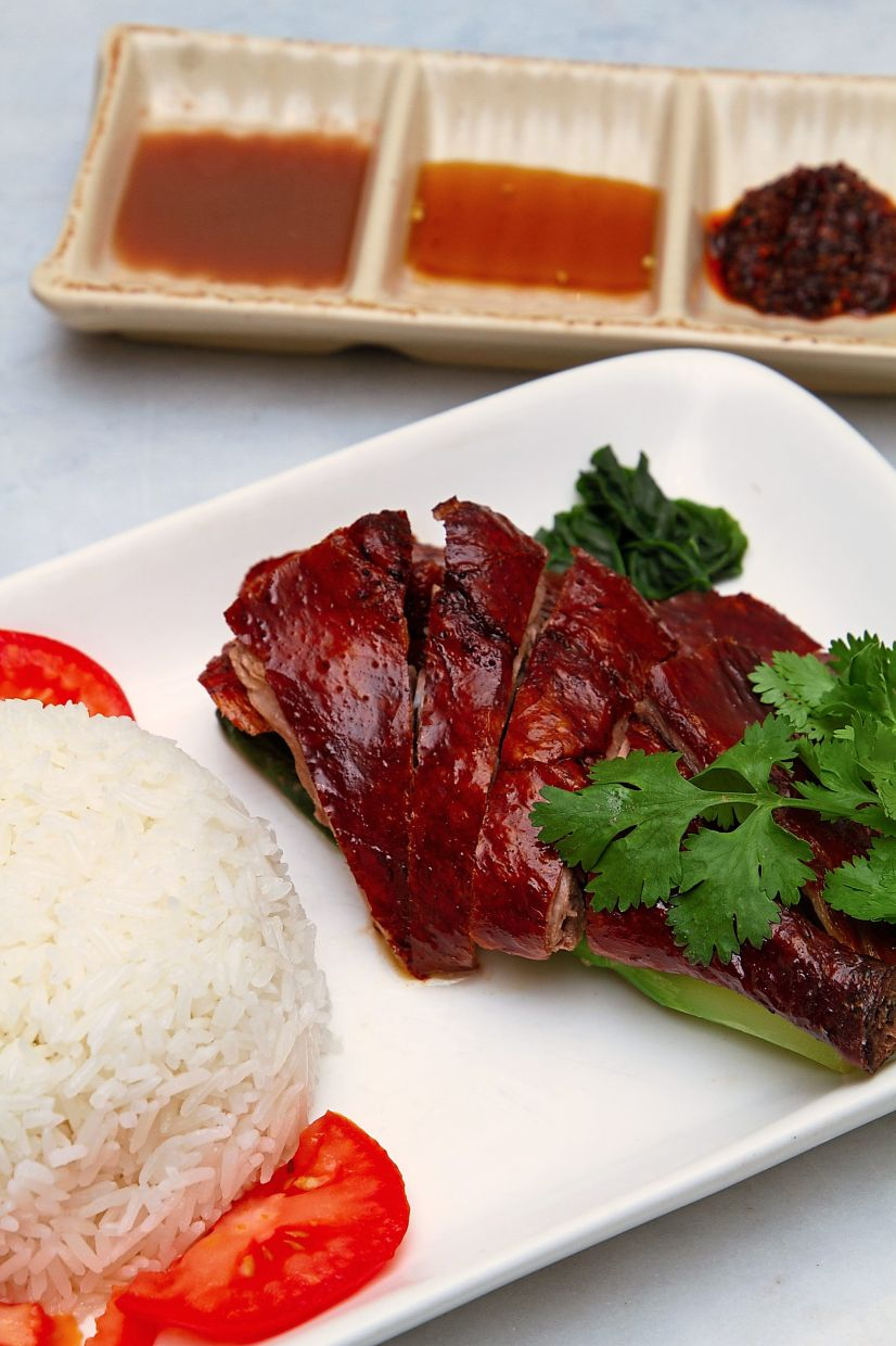 The eatery is known for its signature roast duck rice, which lives up to its reputation and then some.