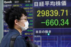 Asian markets mostly down on taper worry, eyes on debt limit