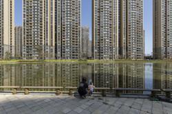 Moody's Analytics: China's property market too big to fail