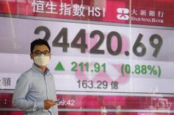 Asia shares mostly fall on China energy and Evergrande worries