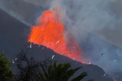 Spain pledges aid to La Palma as erratic eruption keeps island guessing