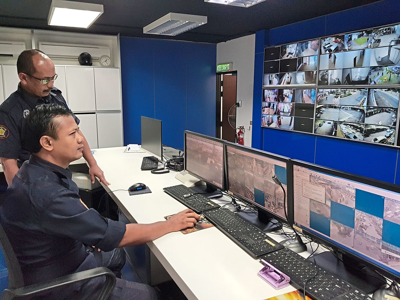 Klang Municipal Council Enforcement CCTV unit officers Mohd Yazid Ahmad (seated) and Azman A. Hamid monitoring the town through surveillance cameras. — Photos: EDWARD RAJENDRA/The Star