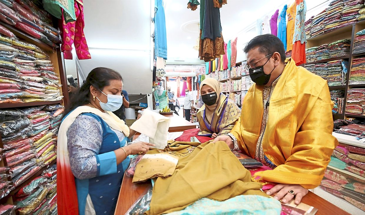 Spoilt for choice: Sulaiman shopping for clothes during his visit to Little India.