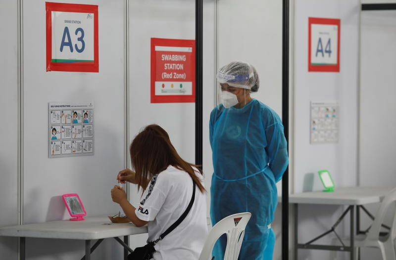 A woman takes her antigen rapid test under supervision at a Quick Test Centre during the coronavirus disease (Covid-19) outbreak, in Singapore on Tuesday (Sept 28). - Reuters