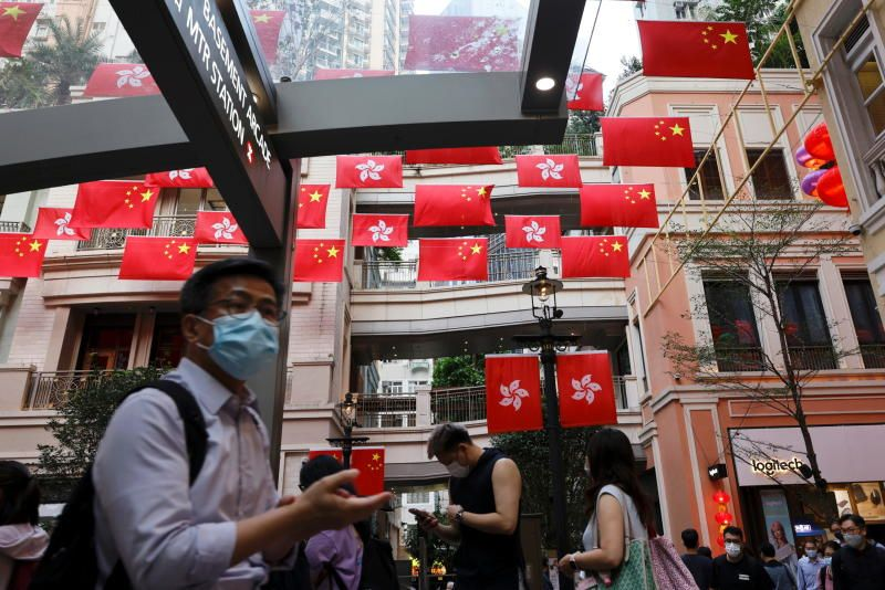 Chinese and Hong Kong flags are pictured outside a mall, ahead of the Chinese National Day which falls on Oct 1, in Hong Kong on Tuesday (Sept 28). - Reuters