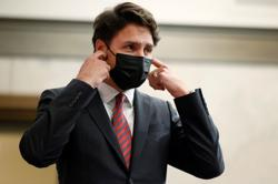 Canada's Trudeau says cabinet coming next month; finance minister to stay