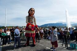 Watch: Giant puppet's European tour raises awareness of plight of child refugees