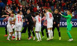 Soccer-Adeyemi penalties earn Salzburg win over Lille