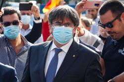 Supporters chant 'freedom' at Catalan leader's extradition heading