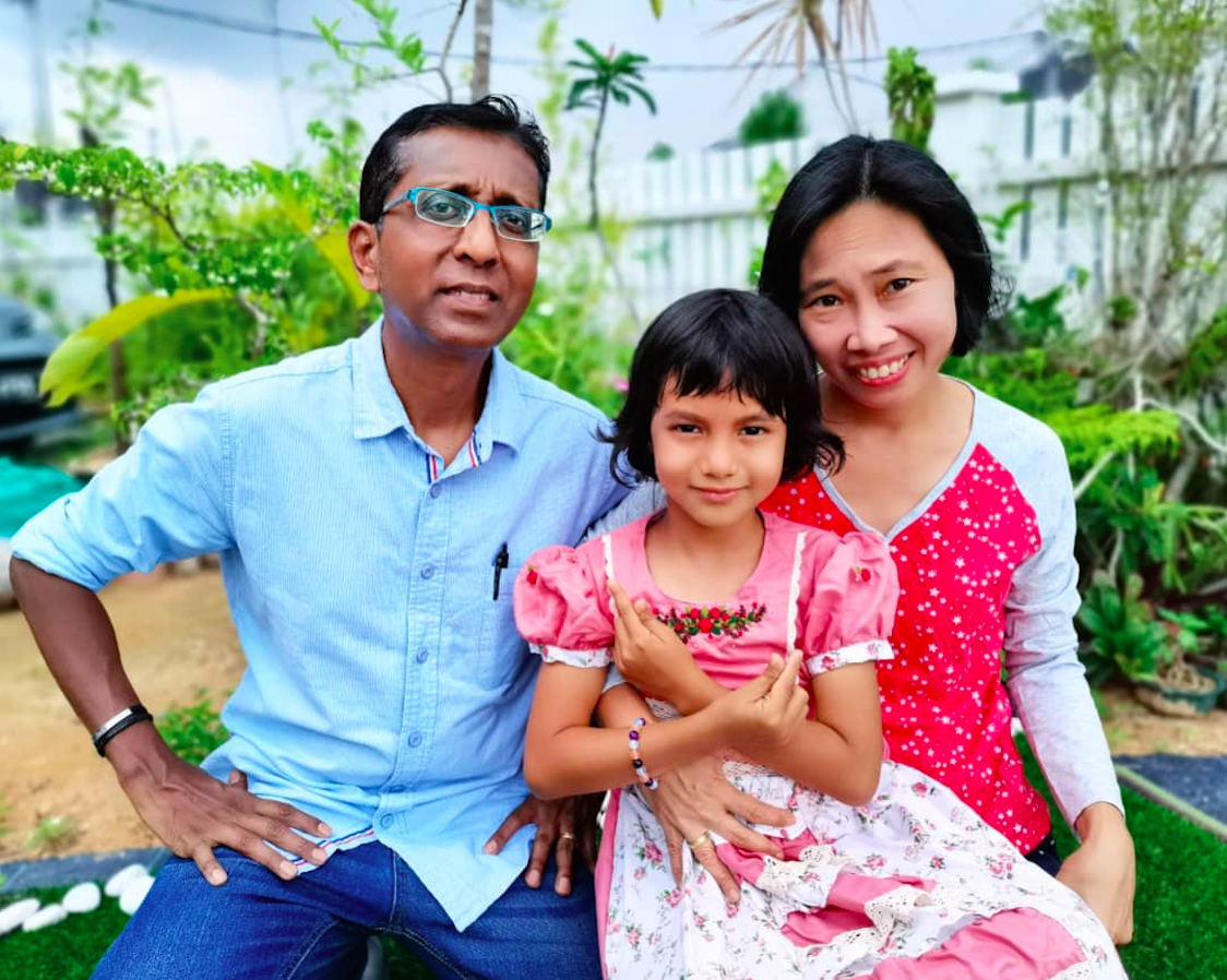 Joseph (pictured with wife Eunice and their daughter Zephanie) says that writing the book helped keep him in a positive frame of mind. Photo: JK Joseph
