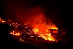 Volcanic lava in Spain's La Palma engulfs more houses, land