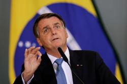 Brazil's unvaccinated president misses soccer match