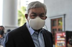 Zahid free to fly for medical treatment after two courts allow temporary return of passport