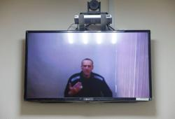 Russia's Navalny says prison has changed his status to