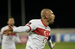 Soccer-Turkey snatch win in Latvia with last-gasp penalty