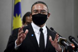 Easing of travel restrictions does not mean relaxing of Covid-19 SOP enforcement, says Hishammuddin