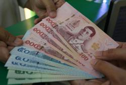 Emerging markets: Thai baht rises more than 1% but other Asian currencies subdued