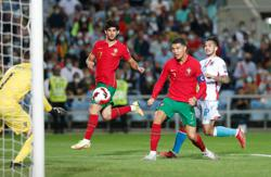 Soccer-Ronaldo nets hat-trick as Portugal rout Luxembourg