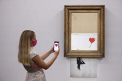 Shredded Banksy canvas 'Love Is In The Bin' sells for record £18.58mil
