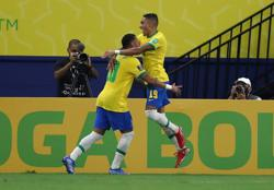 Soccer-Raphinha stars as Brazil cruise past Uruguay 4-1