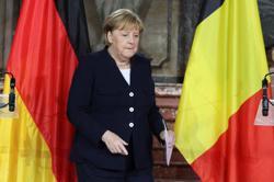 Merkel says EU must resolve Polish problem in talks, not courts