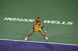 Tennis-Azarenka proud of fight in comeback win over Ostapenko