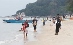 Lively weekend at the beach for holiday-starved Malaysians