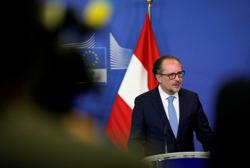Austrian chancellor says government coalition can still work together