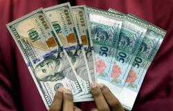 Ringgit poised for technical correction against US dollar this week; to trade between RM4.15 to RM4.16