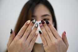 Malaysian salon paints 'Squid Game' manicures of tiny coffins, green tracksuits