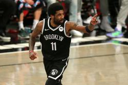 Kyrie Irving's vaccination stance looms large over NBA season