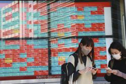 Asian shares slide as Chinese growth data disappoints