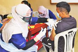 Brunei's vaccination team now reaching out to rural residents