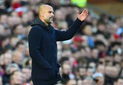 Soccer-I trust the doctors and scientists on vaccination, says Guardiola