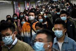 China's new outbreak tied to rule-breaking couple reaches Beijing