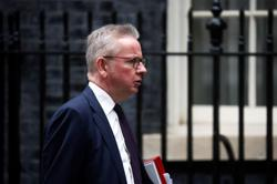 Days after lawmaker's murder prompted fears, UK minister accosted by crowd