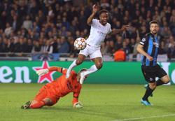 Soccer-Dominant Man City win 5-1 in Bruges