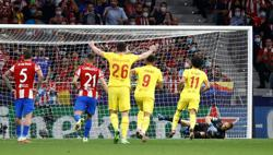 Soccer-Salah double helps Liverpool beat Atletico 3-2 as Griezmann sees red