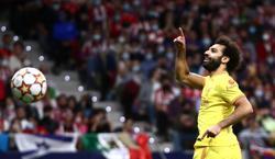 Soccer-Salah sets more milestones as Liverpool survive Madrid scare