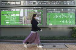 Asian markets rise further on more earnings joy as Fed mulls taper
