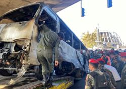 Damascus bomb kills 14, then army shells fall on rebel area killing 12