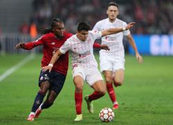 Soccer-Lille continue winless Champions League run with Sevilla draw